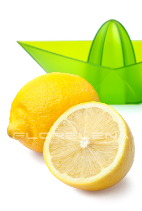 Fresh lemons and lemon juicer