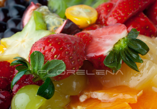 Macro of two strawberries in fruit dessert